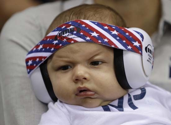 <div class='meta'><div class='origin-logo' data-origin='AP'></div><span class='caption-text' data-credit='AP Photo/Michael Sohn'>United States' Michael Phelps' son Boomer wears ear protection during the swimming competitions</span></div>