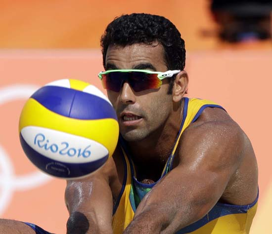<div class='meta'><div class='origin-logo' data-origin='AP'></div><span class='caption-text' data-credit='AP Photo/Marcio Jose Sanchez'>Brazil's Pedro Solberg digs against Canada during a men's beach volleyball match</span></div>