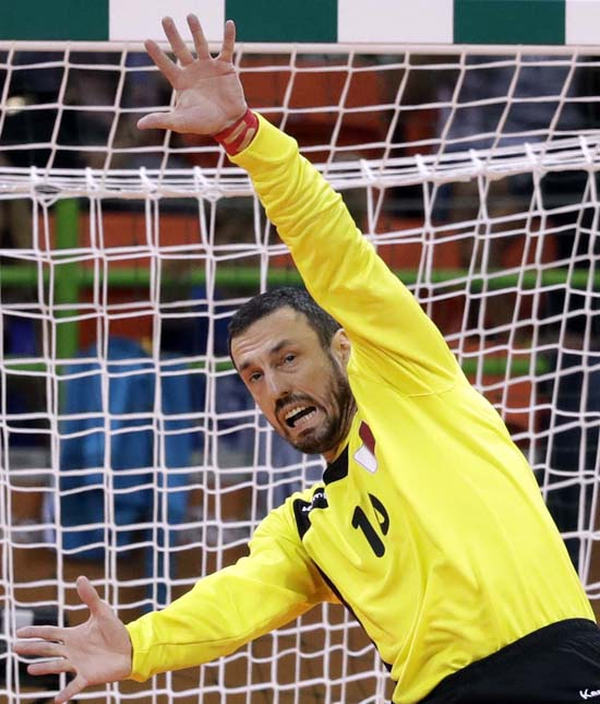 <div class='meta'><div class='origin-logo' data-origin='AP'></div><span class='caption-text' data-credit='AP Photo/Ben Curtis'>France's Cedric Sorhaindo scores a goal past Qatar's Goran Stojanovic during the men's preliminary handball match</span></div>
