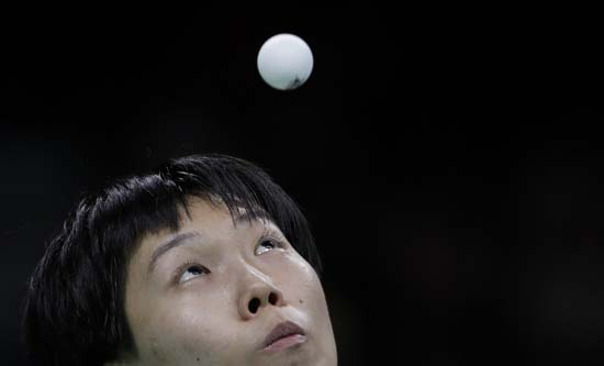 <div class='meta'><div class='origin-logo' data-origin='AP'></div><span class='caption-text' data-credit='AP Photo/Natacha Pisarenko'>Li Xiaoxia of China plays table tennis</span></div>