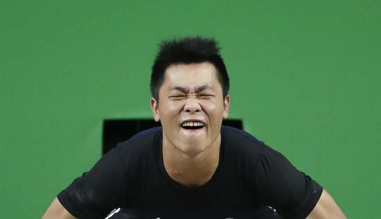 <div class='meta'><div class='origin-logo' data-origin='AP'></div><span class='caption-text' data-credit='AP Photo/Mike Groll'>Pan Chien-Hung, of Taiwan, competes in the men's weightlifting competition</span></div>