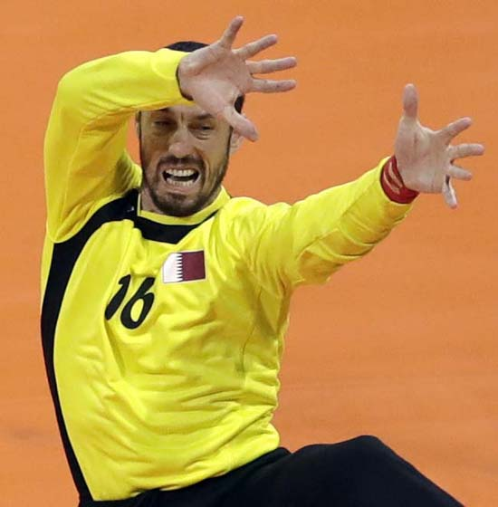 <div class='meta'><div class='origin-logo' data-origin='AP'></div><span class='caption-text' data-credit='AP Photo/Matthias Schrader'>Qatar's Goran Stojanovic tries to catch the ball during the men's preliminary handball match</span></div>
