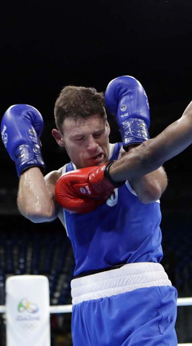 <div class='meta'><div class='origin-logo' data-origin='AP'></div><span class='caption-text' data-credit='AP Photo/Frank Franklin II'>Cuba's Lazaro Alvarez, left, fights Italy's Carmine Tommasone during a men's lightweight 60-kg preliminary boxing match</span></div>