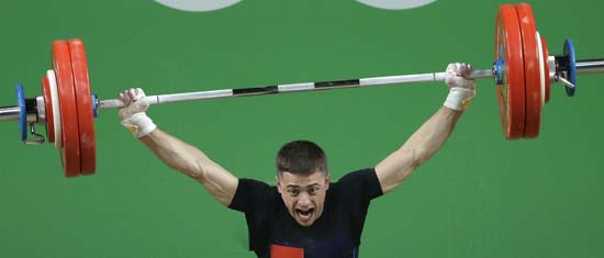 <div class='meta'><div class='origin-logo' data-origin='AP'></div><span class='caption-text' data-credit='AP Photo/Mike Groll'>Serghei Cechir, of Moldova, competes in the men's weightlifting competition</span></div>