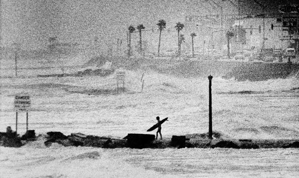 <div class='meta'><div class='origin-logo' data-origin='none'></div><span class='caption-text' data-credit='AP Photo'>A lone surfer walks the rocks of a jetty at Galveston, Texas looking for the big waves that are being produced by Hurricane Alicia as it churns the Gulf of Mexico off Galveston.</span></div>