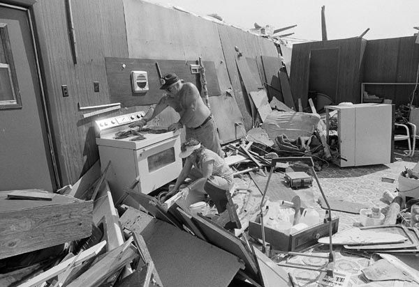 <div class='meta'><div class='origin-logo' data-origin='none'></div><span class='caption-text' data-credit='AP Photo'>Buck and Julia James search through what was once their trailer home in the east of Galveston Island, Friday, August 19, 1983.</span></div>