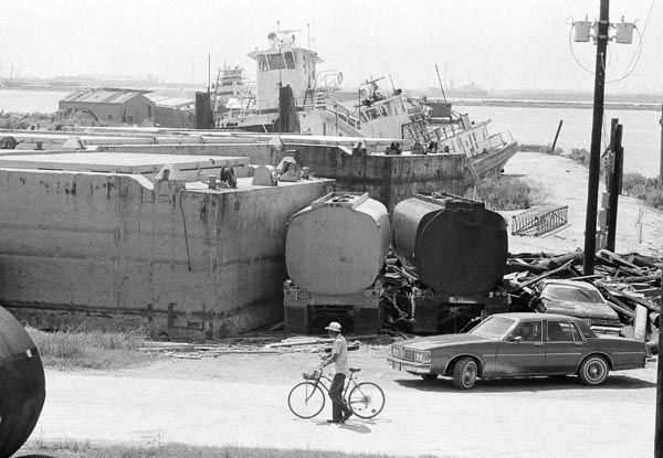 <div class='meta'><div class='origin-logo' data-origin='none'></div><span class='caption-text' data-credit='AP Photo'>James Welch examines tugboats that were pitched from the San Jacinto River which flows into the Galveston Bay, Thursday, August 20, 1983.</span></div>