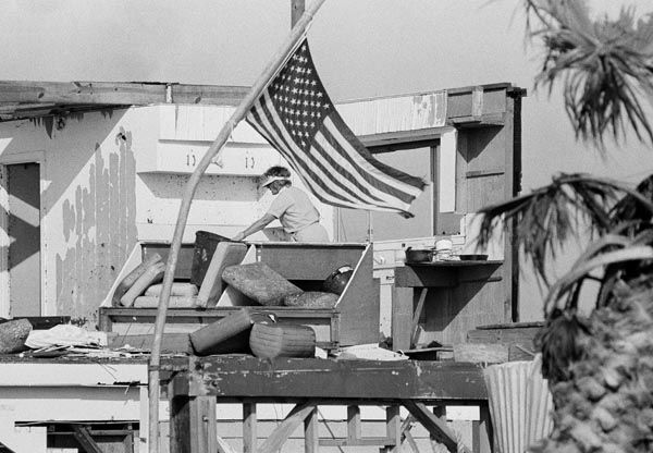 <div class='meta'><div class='origin-logo' data-origin='none'></div><span class='caption-text' data-credit='AP Photo'>Mrs. Floss Wiseman picks through the wreckage of their home on Galveston's West Beach Saturday, August 20, 1983.</span></div>