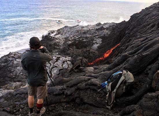 "<div class=""meta image-caption""><div class=""origin-logo origin-image ap""><span>AP</span></div><span class=""caption-text"">A photographer makes pictures of lava from Kilauea, an active volcano on Hawaii's Big Island (AP Photo/Caleb Jones)</span></div>"