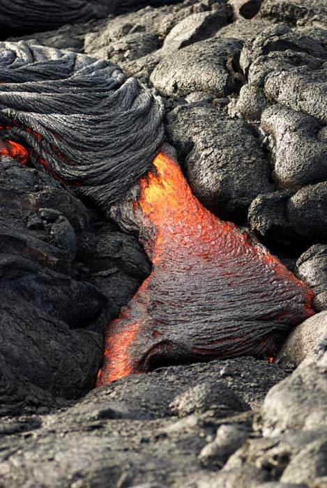 "<div class=""meta image-caption""><div class=""origin-logo origin-image ap""><span>AP</span></div><span class=""caption-text"">Lava from Kilauea, an active volcano on Hawaii's Big Island, flows toward the ocean (AP Photo/Caleb Jones)</span></div>"