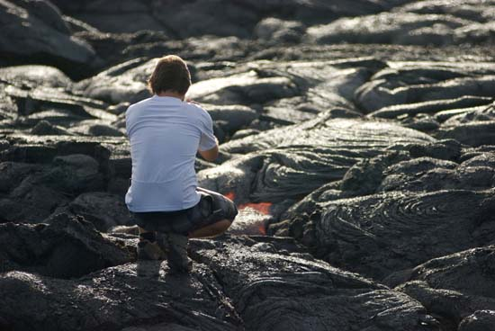 "<div class=""meta image-caption""><div class=""origin-logo origin-image ap""><span>AP</span></div><span class=""caption-text"">Keako Nelson, of Hilo, Hawaii, photographs lava from Kilauea (AP Photo/Caleb Jones)</span></div>"