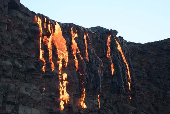 "<div class=""meta image-caption""><div class=""origin-logo origin-image ap""><span>AP</span></div><span class=""caption-text"">Lava from Kilauea, an active volcano on Hawaii's Big Island, flows into the ocean a (AP Photo/Caleb Jones)</span></div>"