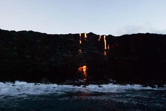 """<div class=""""meta image-caption""""><div class=""""origin-logo origin-image ap""""><span>AP</span></div><span class=""""caption-text"""">Lava from Kilauea, an active volcano on Hawaii's Big Island, flows into the ocean as seen from a boat (AP Photo/Caleb Jones)</span></div>"""