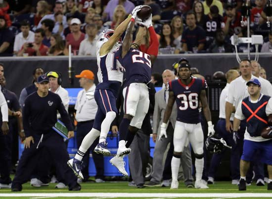 <div class='meta'><div class='origin-logo' data-origin='AP'></div><span class='caption-text' data-credit='David J. Phillip'>Houston Texans free safety Andre Hal (29) intercepts a pass by New England Patriots quarterback Tom Brady intended for New England Patriots wide receiver Devin Lucien.</span></div>