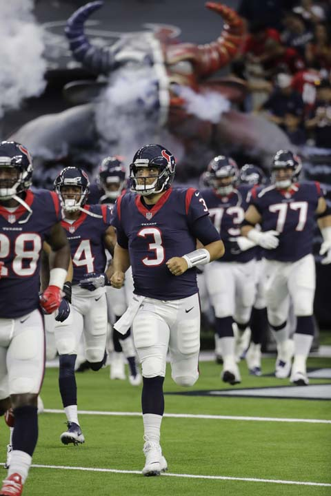 <div class='meta'><div class='origin-logo' data-origin='AP'></div><span class='caption-text' data-credit='David J. Phillip'>Houston Texans quarterback Tom Savage (3) and teammates run out of the tunnel before an NFL football preseason game against the New England Patriots.</span></div>
