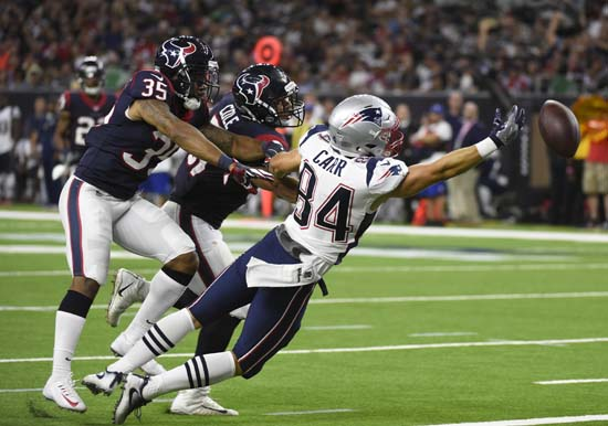 <div class='meta'><div class='origin-logo' data-origin='AP'></div><span class='caption-text' data-credit='Eric Christian Smith'>New England Patriots wide receiver Austin Carr (84) reaches for an overthrown pass as Houston Texans defensive back Eddie Pleasant (35) and linebacker Dylan Cole (51) defend him.</span></div>