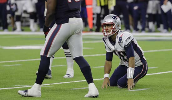<div class='meta'><div class='origin-logo' data-origin='AP'></div><span class='caption-text' data-credit='David J. Phillip'>New England Patriots quarterback Jimmy Garoppolo (10) is slow to stand after he was hit by Houston Texans outside linebacker Tony Washington, left, during the second half.</span></div>