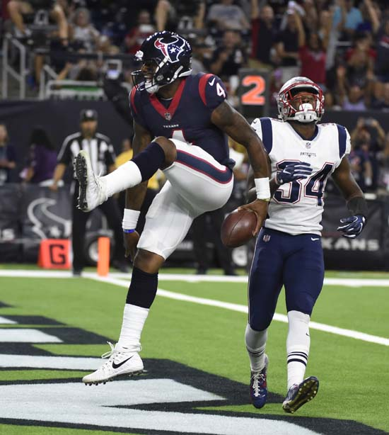 <div class='meta'><div class='origin-logo' data-origin='AP'></div><span class='caption-text' data-credit='Eric Christian Smith'>Houston Texans quarterback Deshaun Watson (4) celebrates his touchdown during the second half of an NFL football preseason game against the New England Patriots.</span></div>