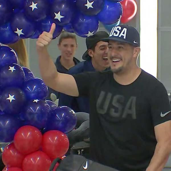 <div class='meta'><div class='origin-logo' data-origin='KTRK'></div><span class='caption-text' data-credit=''>Team USA Olympians arrive at Bush Intercontinental Airport</span></div>