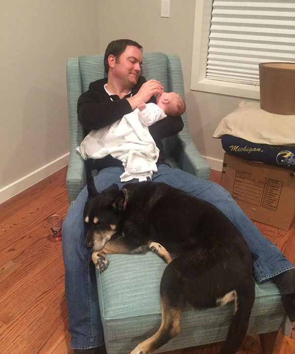 <div class='meta'><div class='origin-logo' data-origin='none'></div><span class='caption-text' data-credit='KTRK/Casey Curry'>ABC-13 Meteorologist Casey Curry's dog Nanook guarding baby Winnie and her hubby</span></div>