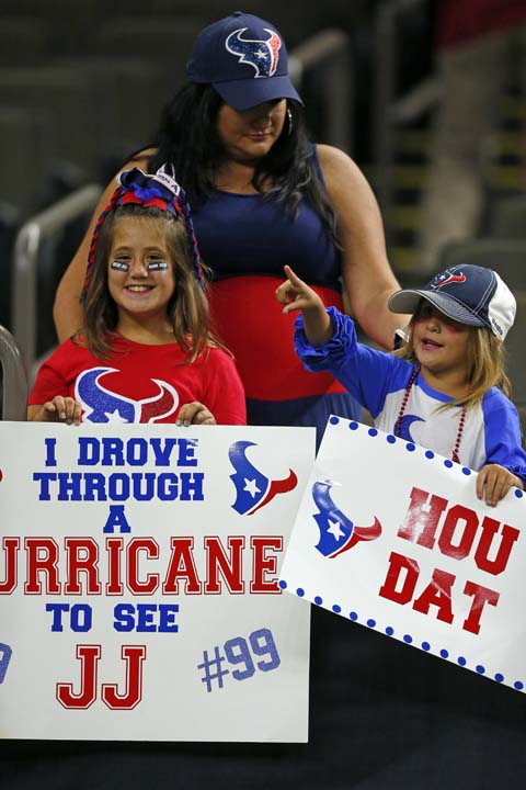 <div class='meta'><div class='origin-logo' data-origin='AP'></div><span class='caption-text' data-credit='AP'>Houston Texans fans holds a sign referring to Hurricane Harvey before a preseason NFL football game against the New Orleans Saints. (AP Photo/Butch Dill)</span></div>