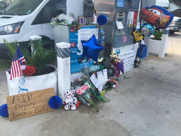 <div class='meta'><div class='origin-logo' data-origin='none'></div><span class='caption-text' data-credit='KTRK/Chauncy Glover'>A make-shift memorial was set up at the gas station where the deputy was gunned down Friday night.</span></div>