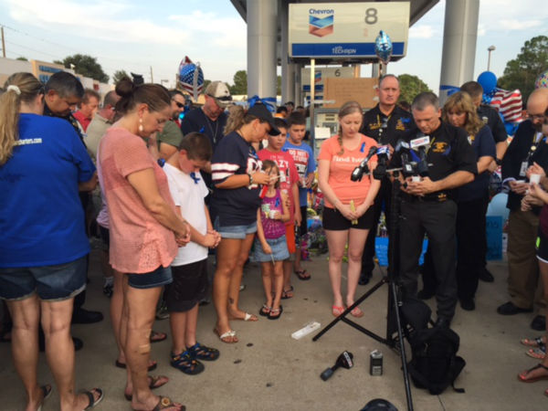 <div class='meta'><div class='origin-logo' data-origin='none'></div><span class='caption-text' data-credit=''>Many gathered at the gas station where the deputy was murdered for a prayer vigil.</span></div>