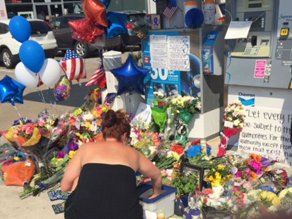 Many gathered at the gas station where the deputy was murdered for a prayer vigil. <span class=meta></span>