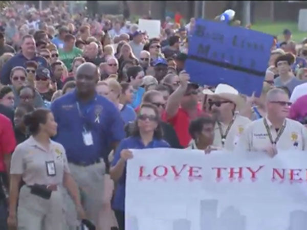 <div class='meta'><div class='origin-logo' data-origin='none'></div><span class='caption-text' data-credit=''>Huge crowd gathers at prayer walk to remember Deputy Goforth in NW Harris County</span></div>
