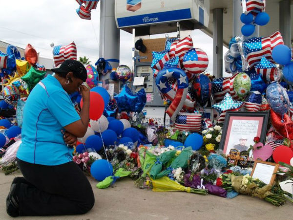 <div class='meta'><div class='origin-logo' data-origin='none'></div><span class='caption-text' data-credit='HCN Photo'>Yolanda Pounds, of Copperfield, knelt to pray next to the growing memorial at the site of the murder of Harris County Deputy Darren Goforth.</span></div>