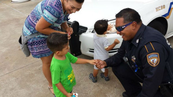 <div class='meta'><div class='origin-logo' data-origin='none'></div><span class='caption-text' data-credit='HCN Photo'>Jacob Castelan, 6, shakes the hand of Harris County Deputy Ticas at the site of the shooting of Deputy Goforth to thank him for his service.</span></div>