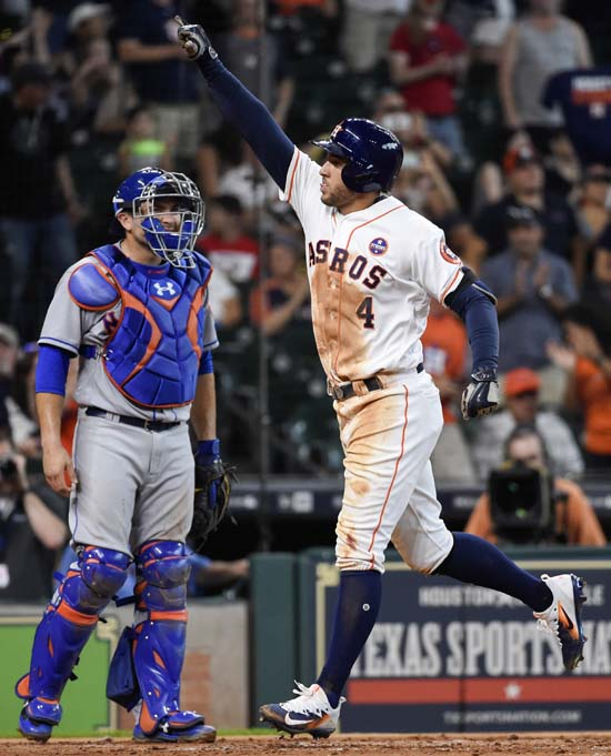 <div class='meta'><div class='origin-logo' data-origin='AP'></div><span class='caption-text' data-credit='Eric Christian Smith'>Houston Astros' George Springer (4) celebrates his two-run home run as New York Mets catcher Travis d'Arnaud looks on during the second inning.</span></div>