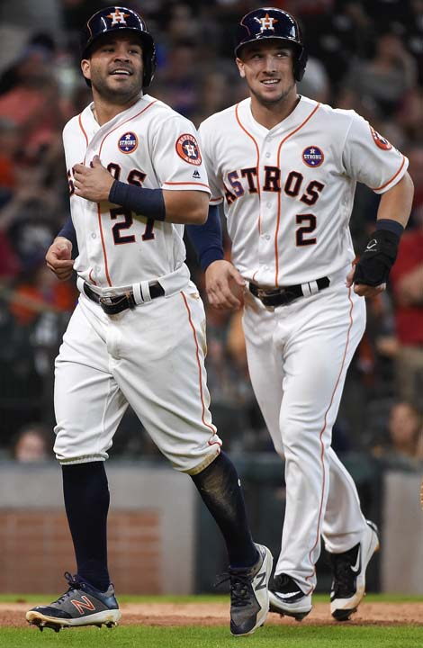 <div class='meta'><div class='origin-logo' data-origin='AP'></div><span class='caption-text' data-credit='Eric Christian Smith'>Houston Astros' Jose Altuve (27) and Alex Bregman jog to the dugout after scoring on Josh Reddick's two-run double during the fifth inning of the first game.</span></div>