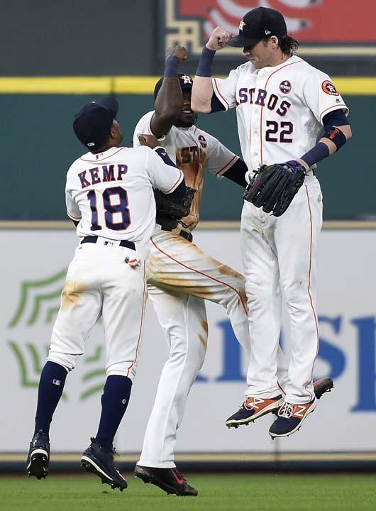 <div class='meta'><div class='origin-logo' data-origin='AP'></div><span class='caption-text' data-credit='Eric Christian Smith'>Houston Astros' Tony Kemp (18), Cameron Maybin, center, and Josh Reddick celebrate the team's win over the New York Mets in the first game of a baseball doubleheader.</span></div>