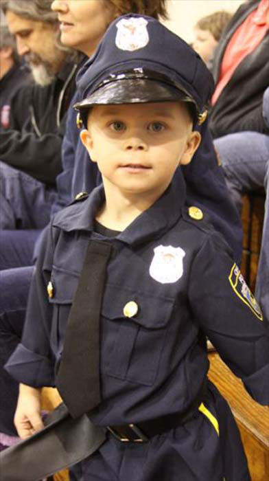 <div class='meta'><div class='origin-logo' data-origin='none'></div><span class='caption-text' data-credit='KTRK Photo/ KTRK'>A child dresses as a law enforcement officer to remember Deputy Darren Goforth</span></div>