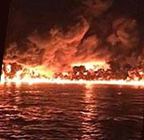 <div class='meta'><div class='origin-logo' data-origin='KTRK'></div><span class='caption-text' data-credit=''>A tanker on fire in the Houston Ship Channel</span></div>