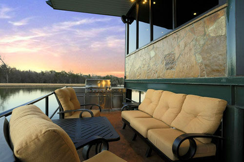 "<div class=""meta image-caption""><div class=""origin-logo origin-image none""><span>none</span></div><span class=""caption-text"">This one of a kind 'glass house' has 3-levels of breath-taking views. The luxury home sits on a private lake and is only accessible by boat or bridge. (Bill Krampitz/TK Images  )</span></div>"