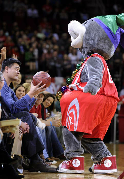<div class='meta'><div class='origin-logo' data-origin='none'></div><span class='caption-text' data-credit='AP Photo/ Pat Sullivan'>Former Houston Rockets player Yao Ming, left, holds out a basketball from team mascot Clutch during a time out in the first half of an NBA basketball game.</span></div>