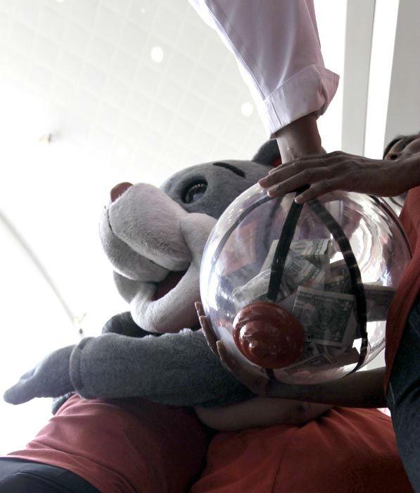 <div class='meta'><div class='origin-logo' data-origin='none'></div><span class='caption-text' data-credit='AP Photo/ David J. Phillip'>Sarah Joseph, right, holds a donation bucket as Houston Rockets employees and family members line up to hug the Rockets' mascot, Clutch.</span></div>