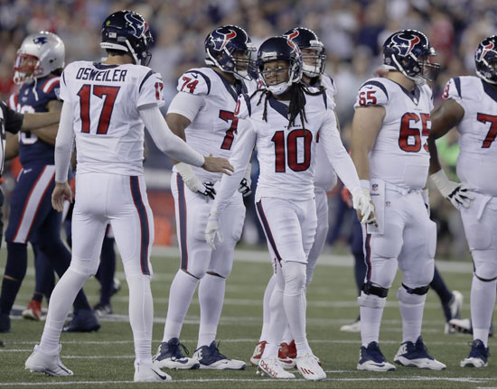 "<div class=""meta image-caption""><div class=""origin-logo origin-image ap""><span>AP</span></div><span class=""caption-text"">Houston Texans quarterback Brock Osweiler (17) speaks to wide receiver DeAndre Hopkins (10) during the first half of an NFL football game against the New England Patriots. (Charles Krupa)</span></div>"