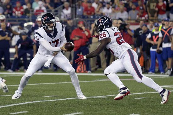 "<div class=""meta image-caption""><div class=""origin-logo origin-image ap""><span>AP</span></div><span class=""caption-text"">Houston Texans quarterback Brock Osweiler (17) hands off to running back Lamar Miller (26) during the first half of an NFL football game against the New England Patriots. (Charles Krupa)</span></div>"