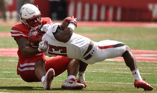 "<div class=""meta image-caption""><div class=""origin-logo origin-image ap""><span>AP</span></div><span class=""caption-text"">Texas Tech wide receiver Cameron Batson (13) is tackled by Houston linebacker Emeke Egbule during the first half of an NCAA college football game. (Eric Christian Smith)</span></div>"