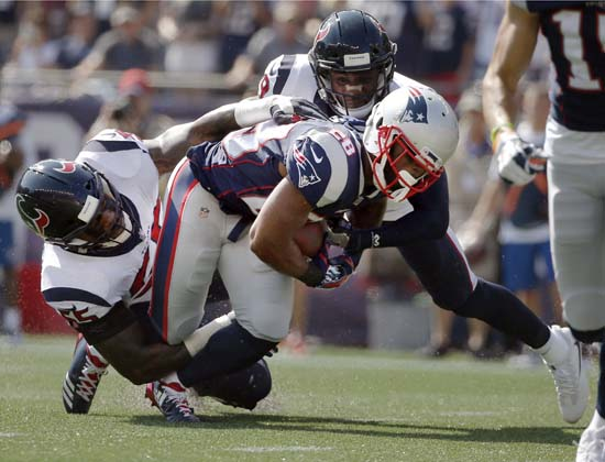 <div class='meta'><div class='origin-logo' data-origin='AP'></div><span class='caption-text' data-credit='Michael Dwyer'>Houston Texans linebacker Benardrick McKinney, left, and safety Andre Hal, right, tackle New England Patriots running back James White (28) during the first half.</span></div>