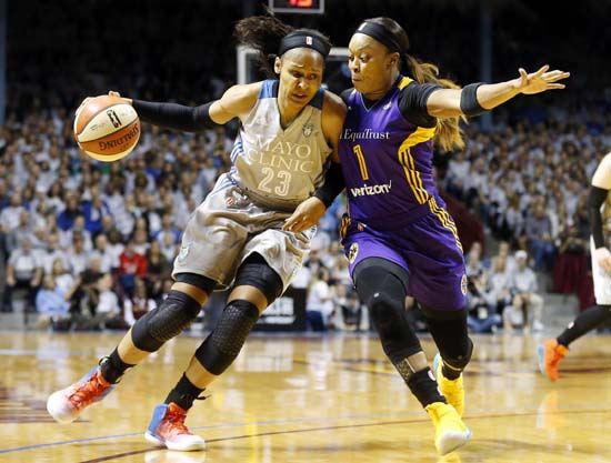<div class='meta'><div class='origin-logo' data-origin='AP'></div><span class='caption-text' data-credit='Jim Mone)'>Minnesota Lynx's Maya Moore, left, drives around Los Angeles Sparks' Odyssey Sims in the first half during Game 5 of the WNBA Finals Wednesday, Oct. 4, 2017, in Minneapolis.</span></div>