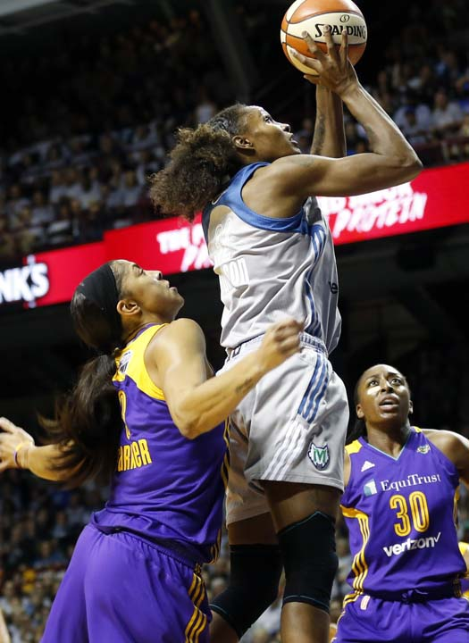 <div class='meta'><div class='origin-logo' data-origin='AP'></div><span class='caption-text' data-credit='Jim Mone)'>Minnesota Lynx's Rebekkah Brunson, right, jumps high above Los Angeles Sparks' Candace Parker as she shoots in the first half during Game 5 of the WNBA Finals.</span></div>