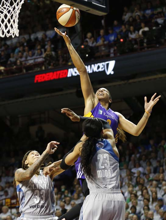 <div class='meta'><div class='origin-logo' data-origin='AP'></div><span class='caption-text' data-credit='Jim Mone)'>Los Angeles Sparks' Candace Parker, top, shoots over Minnesota Lynx's Seimone Augustus, left, and Maya Moore in the second half during Game 5 of the WNBA Finals.</span></div>
