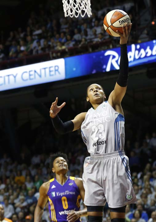 <div class='meta'><div class='origin-logo' data-origin='AP'></div><span class='caption-text' data-credit='Jim Mone'>Minnesota Lynx's Maya Moore, right, lays up a shot as Los Angeles Sparks' Alana Beard looks on in the first half during Game 5 of the WNBA Finals.</span></div>