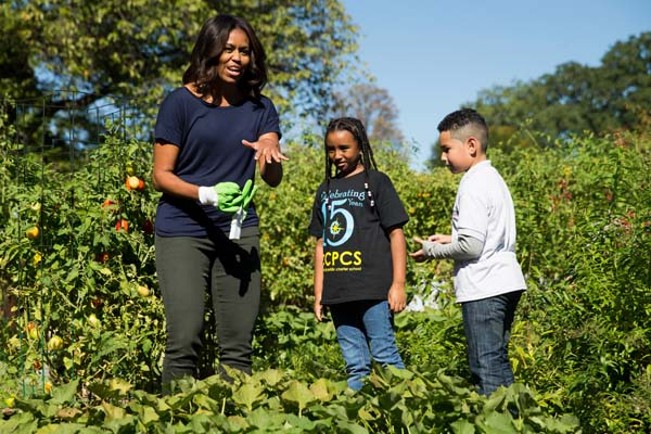 "<div class=""meta image-caption""><div class=""origin-logo origin-image ap""><span>AP</span></div><span class=""caption-text"">First lady Michelle Obama jokes that she needs to put on gloves to protect her manicure during a harvest of the White House Kitchen Garden (AP Photo/Andrew Harnik)</span></div>"