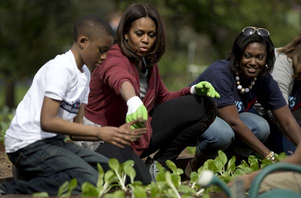 "<div class=""meta image-caption""><div class=""origin-logo origin-image ap""><span>AP</span></div><span class=""caption-text"">First lady Michelle Obama, joined by students from across the country, plants vegetables during the seventh annual White House Kitchen Garden Planting (AP Photo/Carolyn Kaster)</span></div>"
