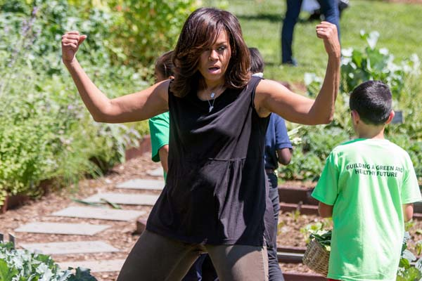 "<div class=""meta image-caption""><div class=""origin-logo origin-image ap""><span>AP</span></div><span class=""caption-text"">First lady Michelle Obama jokingly flexes her muscles for members of the media as she harvests the White House Kitchen Garden (AP Photo/Andrew Harnik)</span></div>"